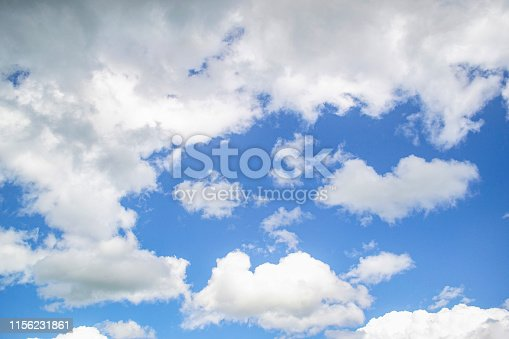 Fluffy clouds and blue sky on a summer's day