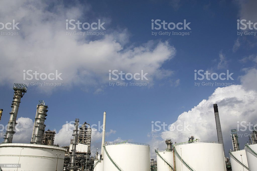 cloudscape over an oil refinery stock photo