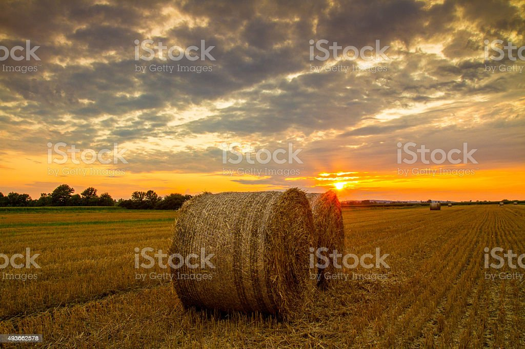 Cloudscape Over Bales Of Wheat stock photo