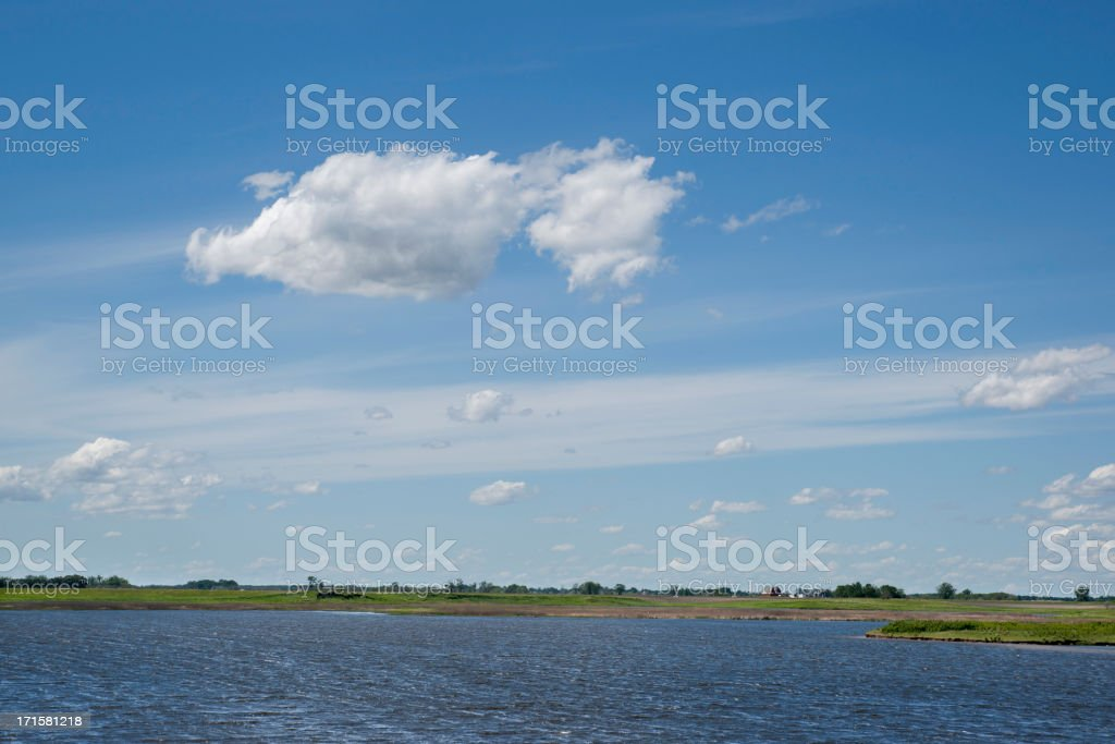 cloudscape over land and water royalty-free stock photo