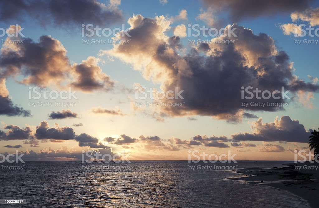 Cloudscape over Ocean and Island at Sunset royalty-free stock photo