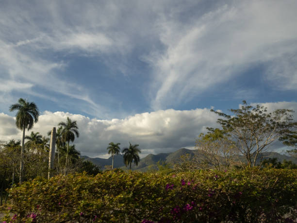 Cloudscape over the hills and vegetation of Cuba stock photo