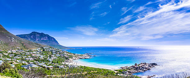 Cloudscape panorama of Hout Bay in Cape Town Cloudscape panorama of Hout Bay in Cape Town, South Africa, seen along the coastal route from Hout Bay to Cape Town. hout stock pictures, royalty-free photos & images