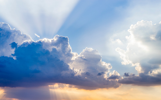 Colorful sky with clouds and sun background.