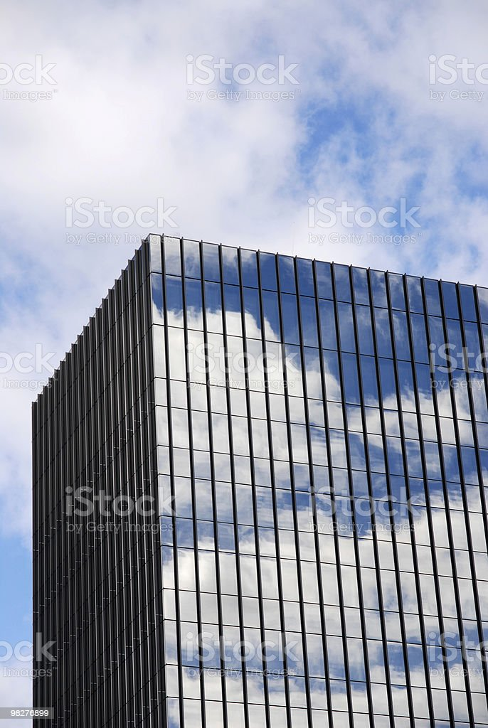 Cloudscape reflections on a skyscraper glass facade royalty-free stock photo