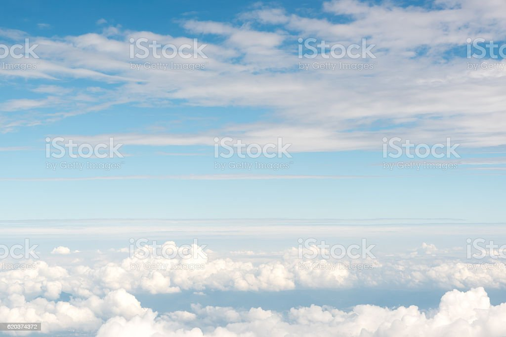 Cloudscape view above white clouds and blue sky from airplane zbiór zdjęć royalty-free
