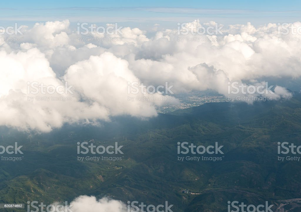Cloudscape view with mountain above white clouds and blue sky zbiór zdjęć royalty-free