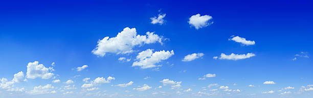 Cloudscape - White clouds in the blue sky stock photo