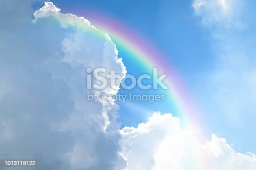 istock Cloudscape with blue sky and white clouds rainbow 1013115122