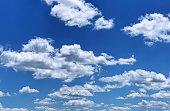 Cloudscape with cumulus clouds and blue sky