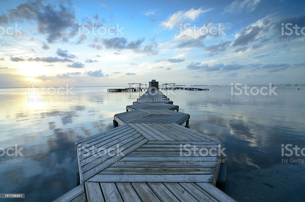 Cloudscape with reflections in a zigzag dock stock photo