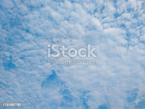 istock cloudscape with white altocumulus clouds at evening 1131567782