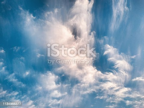 istock cloudscape with white altocumulus clouds at evening 1134966377