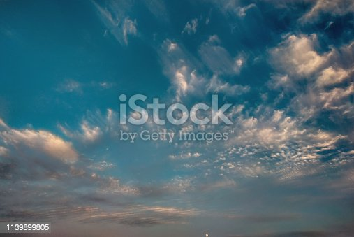 istock cloudscape with white altocumulus clouds at evening 1139899805