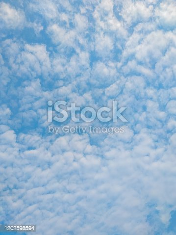 istock cloudscape with white altocumulus clouds at evening 1202598594