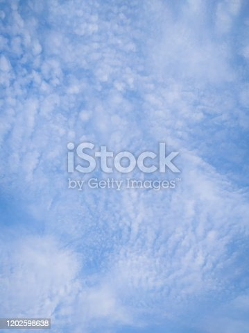 istock cloudscape with white altocumulus clouds at evening 1202598638
