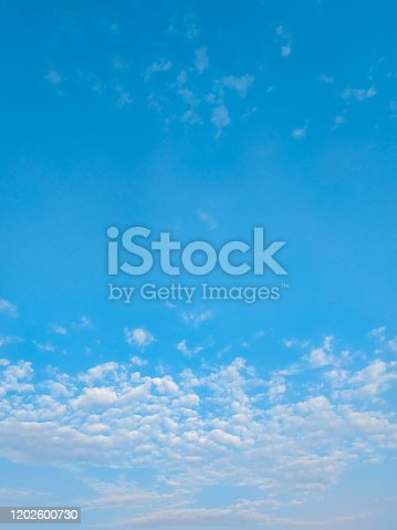istock cloudscape with white altocumulus clouds at evening 1202600730