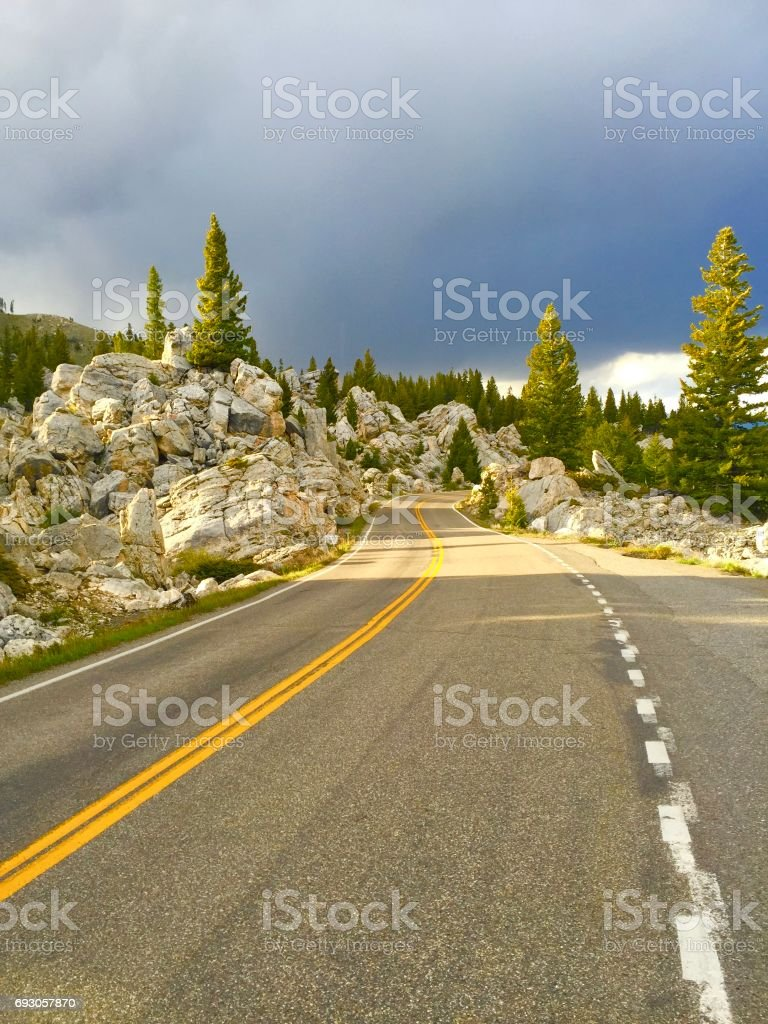 cloudy and lonely road stock photo
