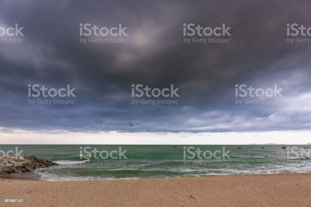 cloudy and strom at the beach stock photo