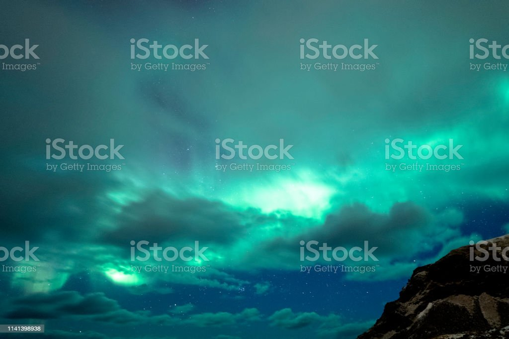 Cloudy Auroras stock photo