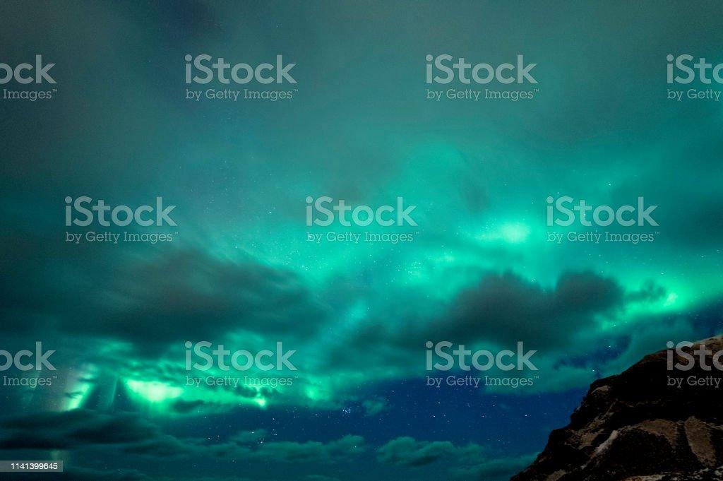 Cloudy Auroras stock photo