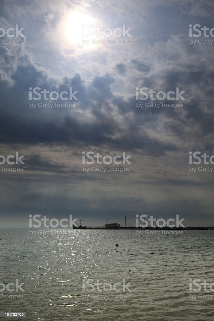 Cloudy blue sky above a surface of the sea royalty-free stock photo
