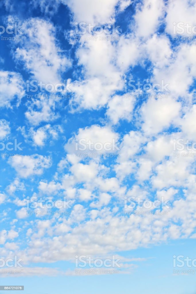Cloudy blue sky as vertical nature background. stock photo