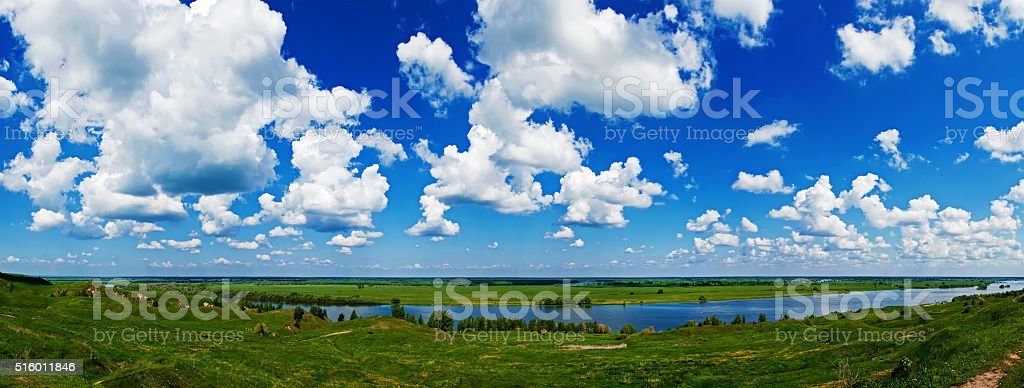 cloudy blue sky over gently rolling patchwork farmland stock photo