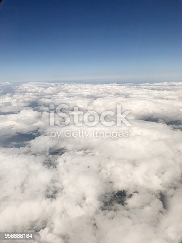 istock Cloudy blue sky 956888184