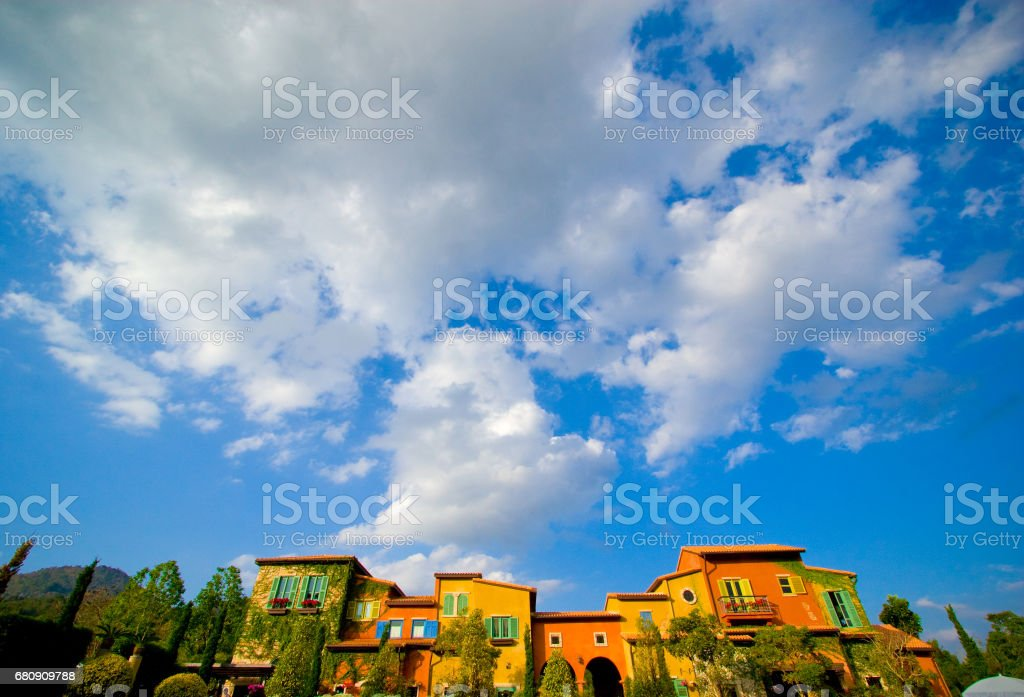 Cloudy blue sky with vintage small village royalty-free stock photo