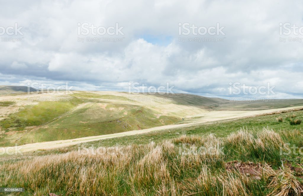 Cloudy bright view down to the grassy hills near to Pan Y Fan in Brecon Beacons, Wales stock photo