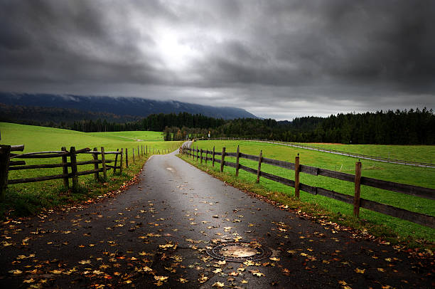 Cloudy country road stock photo