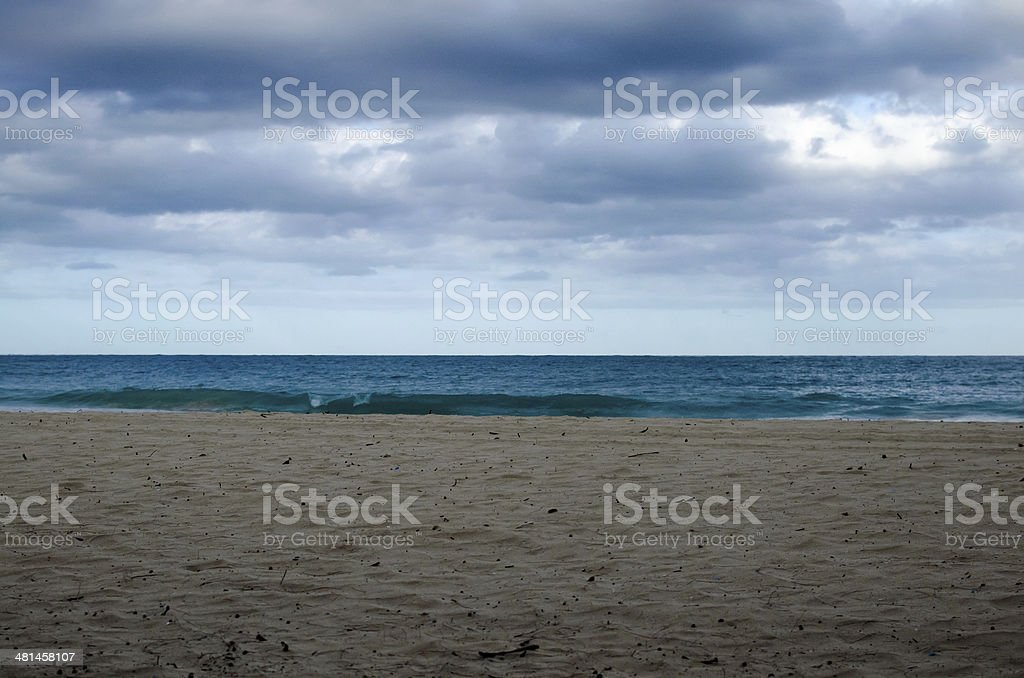 Cloudy day at the beach- horizontal stock photo