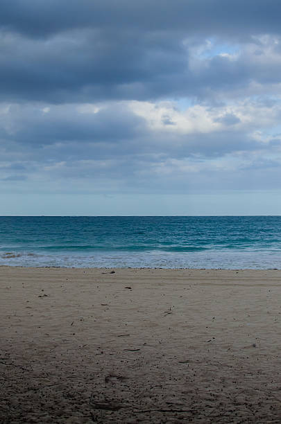 Cloudy day at the beach- vertical stock photo