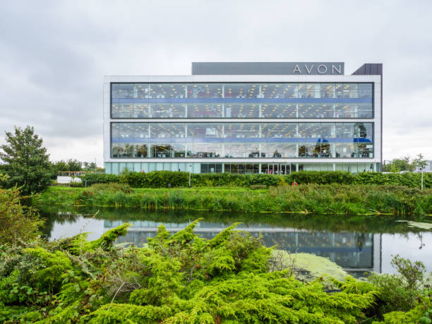 Cloudy day view of Avon Head Offices next to Nene River Northampton, UK - Aug 21, 2017: Cloudy day view of Avon Head Offices next to Nene River. avon colorado stock pictures, royalty-free photos & images