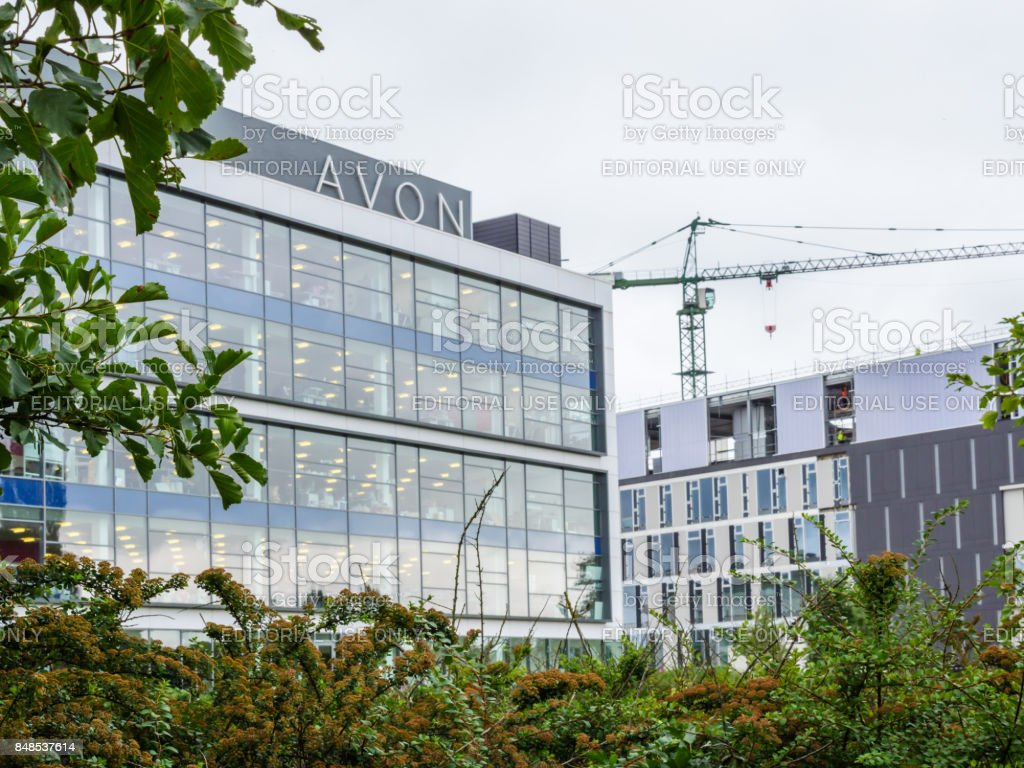 Cloudy day view of Avon Head Offices next to Nene River stock photo