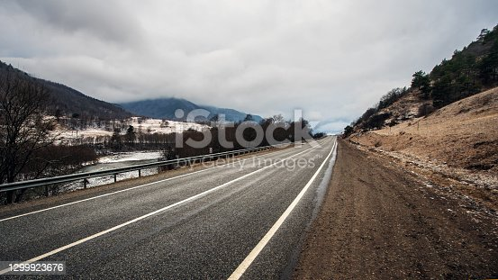Cloudy morning over the road in the mountains