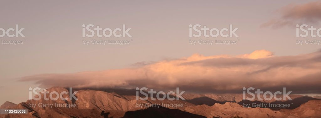 Clouds at sunrise over a mountain