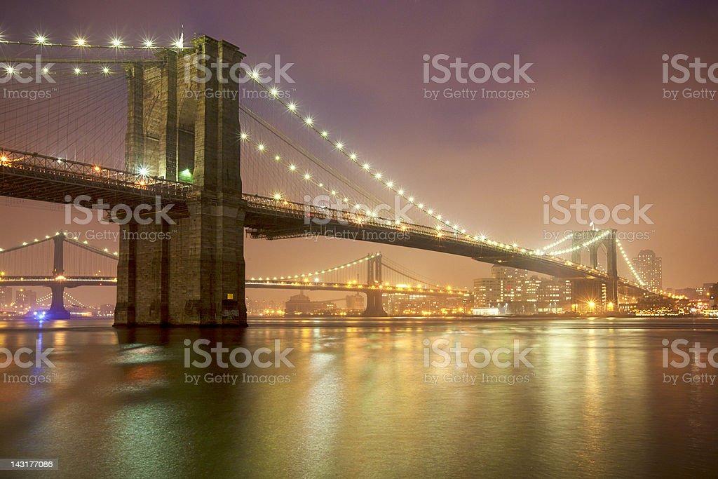 Cloudy night in Brooklyn Bridge stock photo