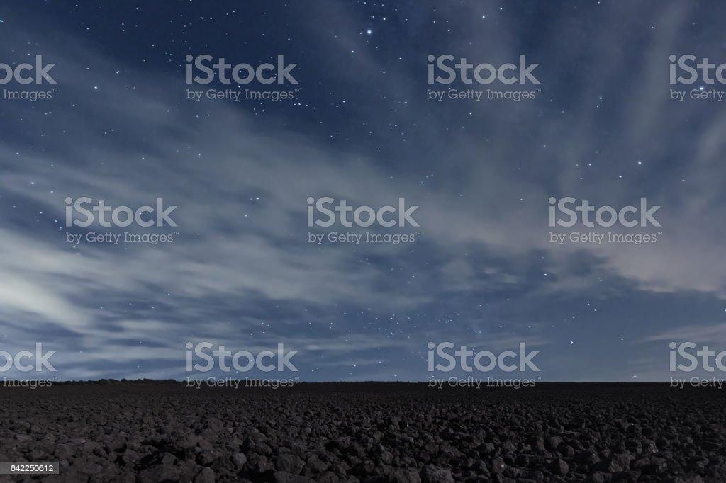 Cloudy Night sky with stars. Night background. Night sky. stock photo