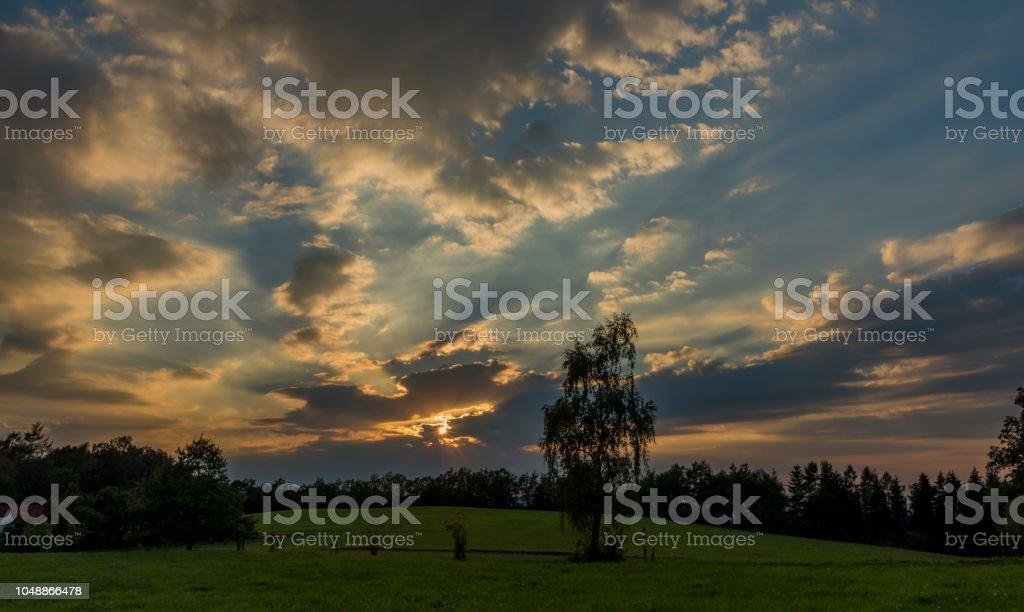 Cloudy orange blue sunset near Ceske Budejovice city stock photo