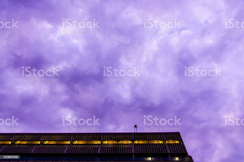 Cloudy purple sky over building stock photo