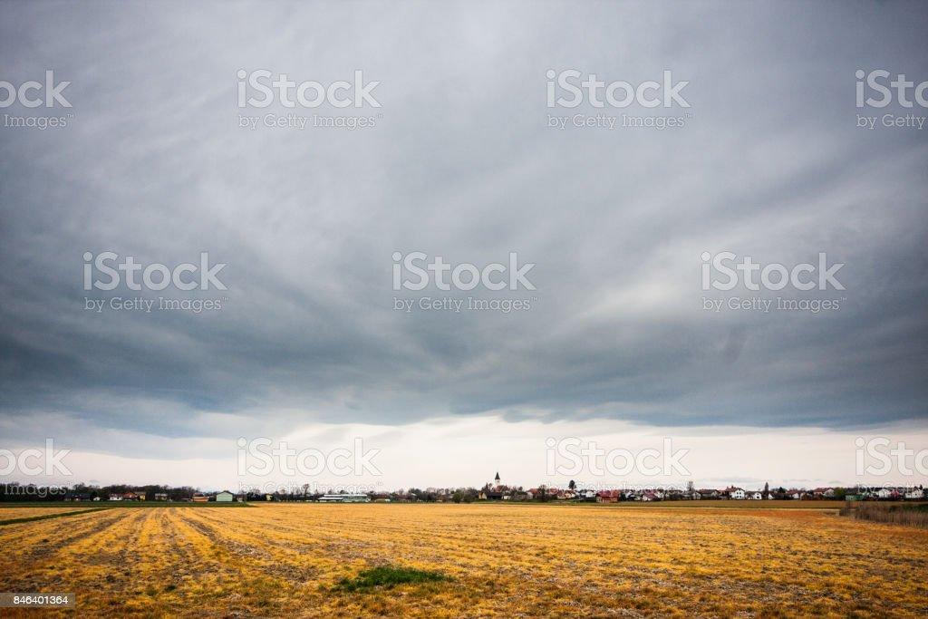 Cloudy skies over empty fields in Gorcko, Slovenia. stock photo