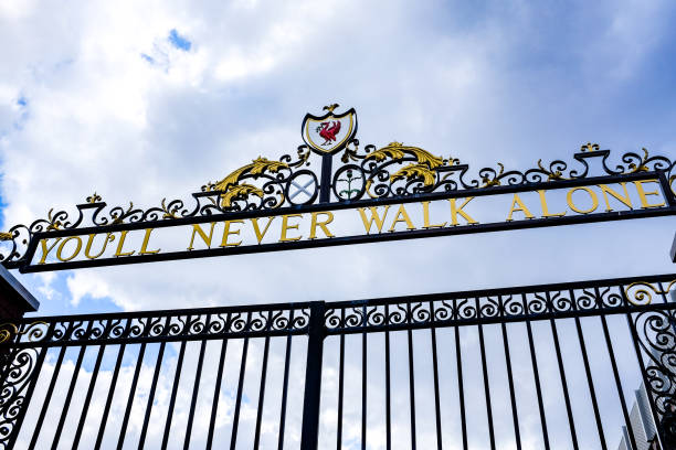 Cloudy Sky above the Bill Shankly Memorial Gates at Liverpool's Anfield Stadium. The gates have its famous slogan,