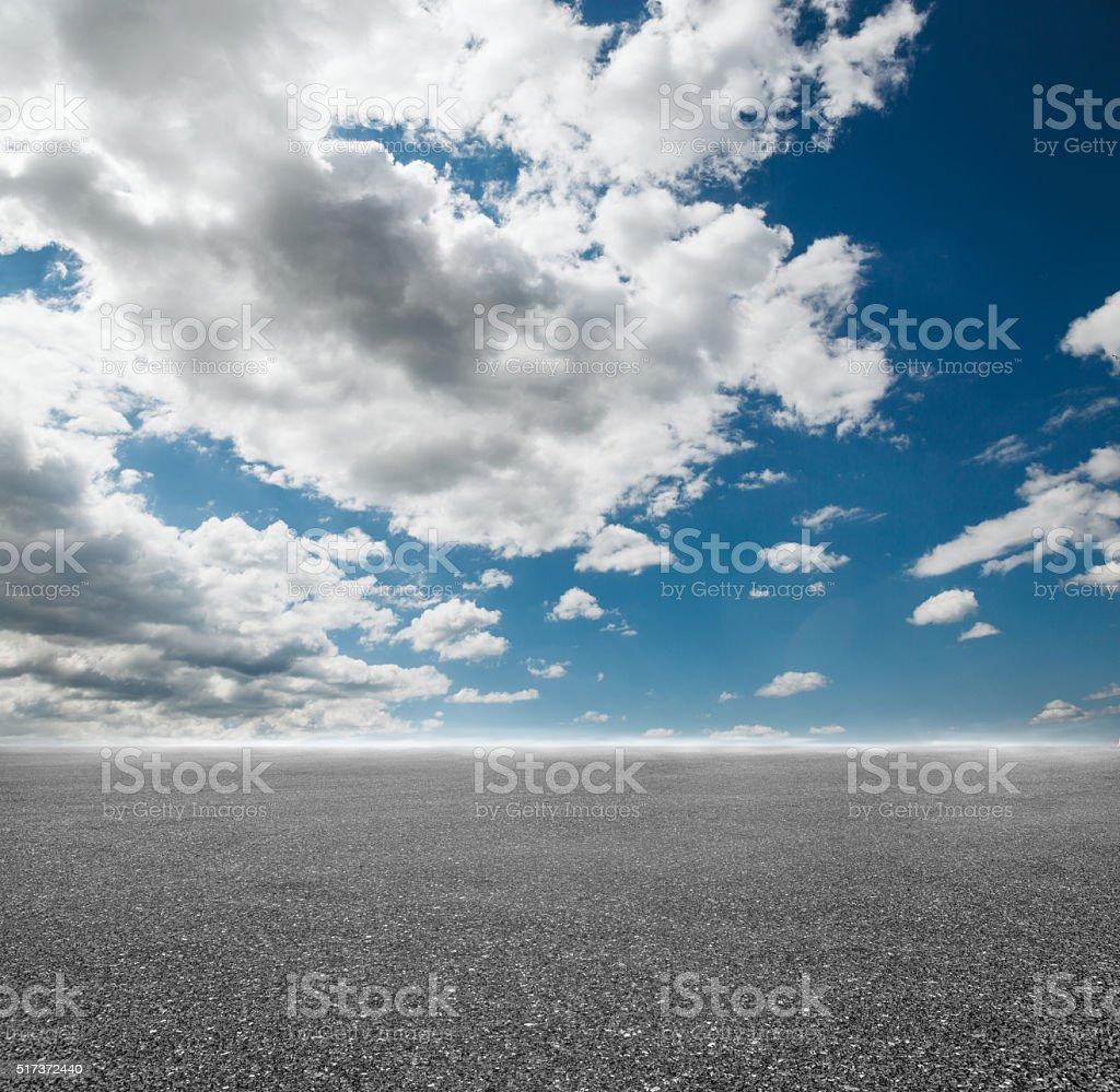 Cloudy sky and asphalt stock photo