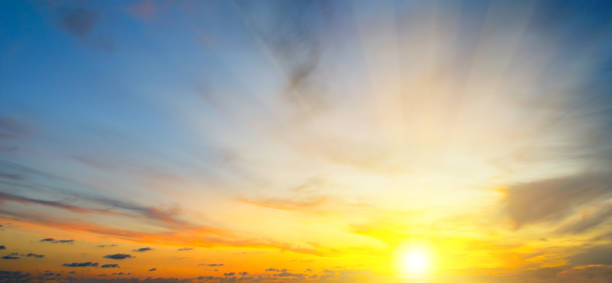 Cloudy sky and bright sun rise over the horizon. Cloudy sky and bright sun rise over the horizon. Wide photo. sunrise stock pictures, royalty-free photos & images