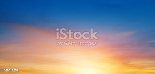 Cloudy sky and bright sun rise over the horizon. Wide photo .