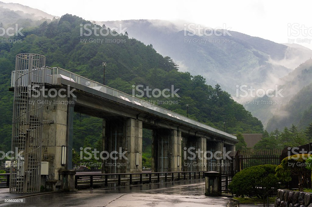 cloudy sky and dam,mountain,water gate stock photo