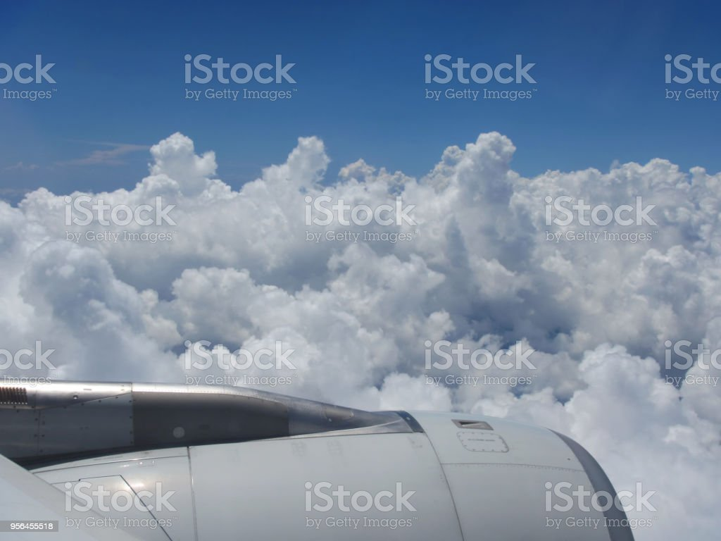 Cloudy sky from plane stock photo