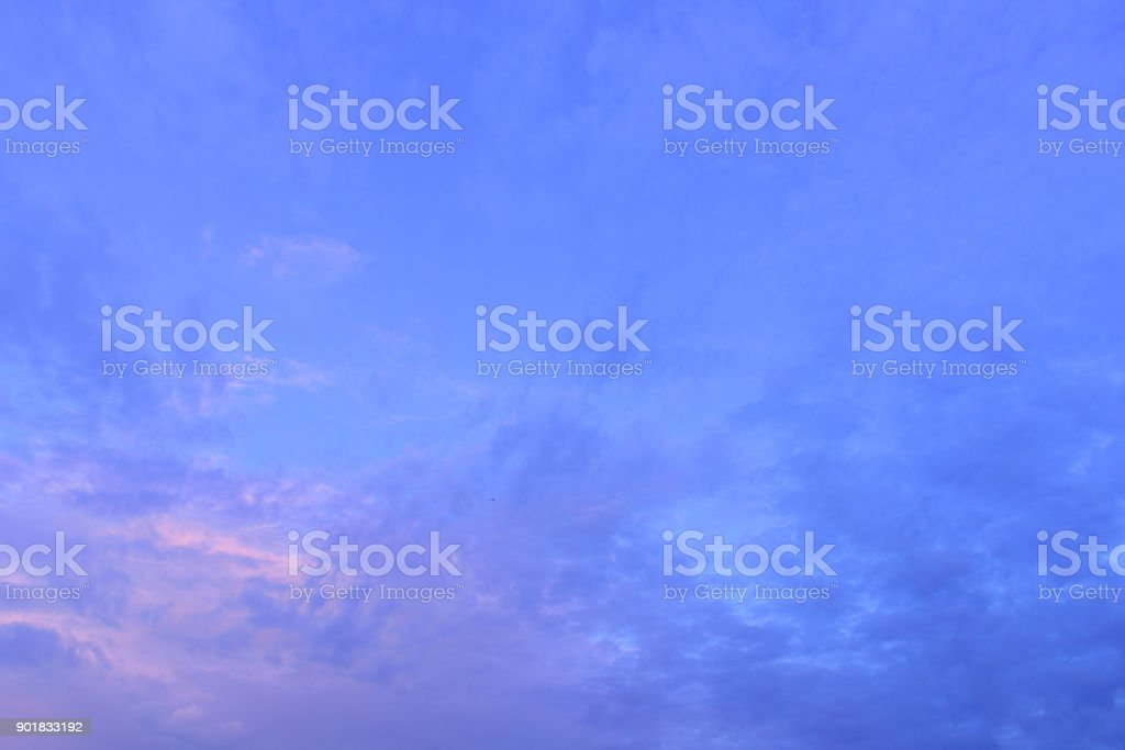 Cloudy sky group with condensation in evening before sunset and raining. stock photo